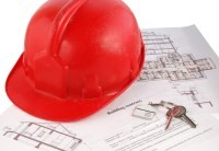 Image of red hard hat on construction plans